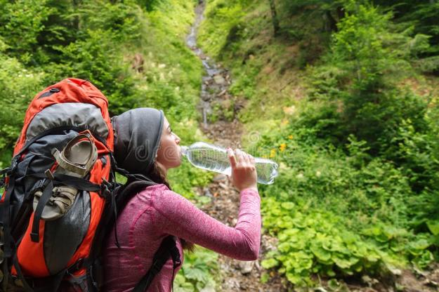 hiker-girl-drinking-water-woman-tourist-backpack-nature-young-tourist-woman-outdoor-forest-77470488